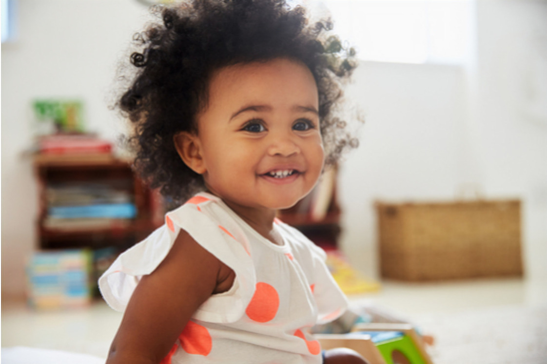 Cute baby girl smiling age 1 magic